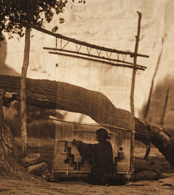 Navajo weaver at loom, c. 1900
