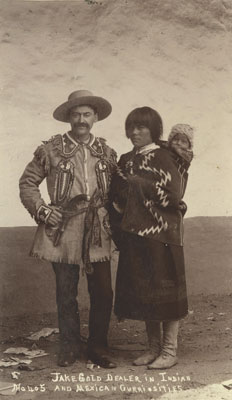 Jake Gold and unidentified Pueblo woman with child,