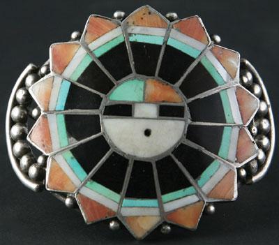 Zuni Sunface Kachina Inlay Bracelet    c. 1940