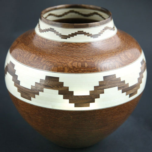 Glen Crandall     Oak, Holly, and Walnut Wooden Vessel with Fishtale Design     7.5 x 8.25